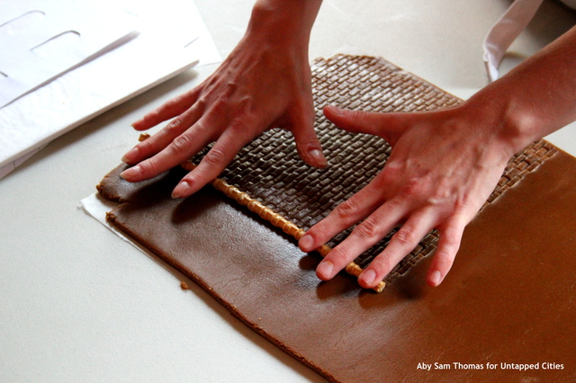 Renee Baumann rolls out the brick pattern on the gingerbread dough.