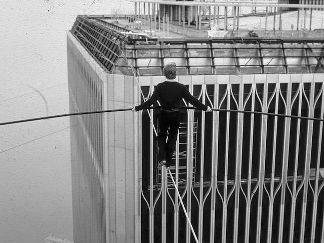 French aerialist Philippe Petit crosses a steel cable between the Twin Towers